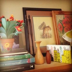 My flight log, a paper cactus, wooden vases.